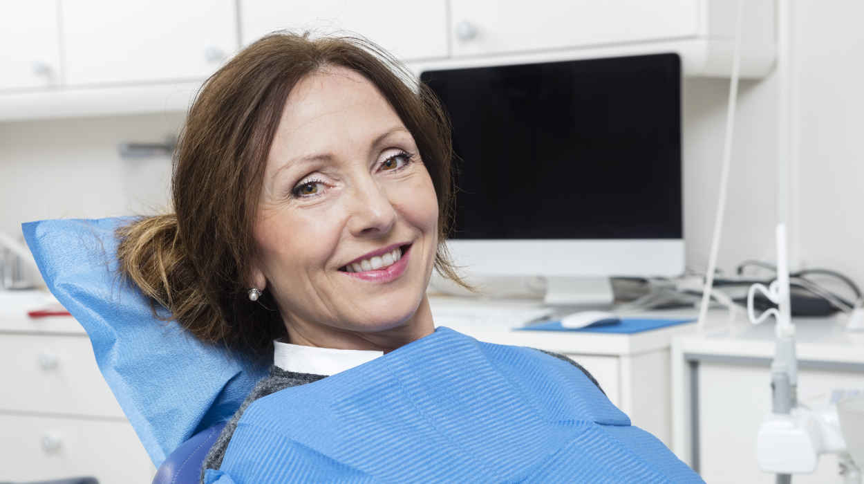 older woman on a dentist chair